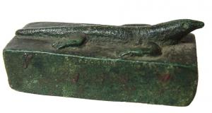 Late Period Ptolemaic Egyptian bronze sarcophagus of a lizard, (circa 664-30 BC), associated with the god Atum, a nice example with good detail (est. $450-$700).