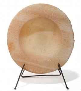 Cypriot alabaster dish from the 4th or 5th century BC, carved from attractive banded stone and featuring a rounded bottom and a wide, flat rim, 3 ½ inches in diameter (est. $600-$900).