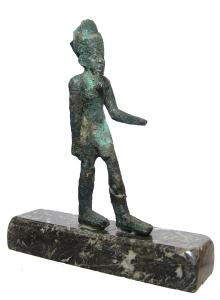 Egyptian bronze striding figure of Amun from the Late Period, circa, 664-332 BC, depicted wearing a short skirt, feathered headdress and false beard. 4 ¾ inches tall (est. $600-$1,000).