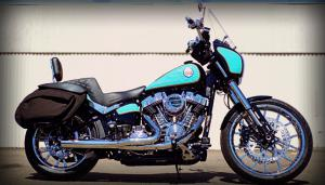 Inspired by the original FXLR artistry, Free Bird is trimmed in chrome, custom gold pinstriped graphics, sky blue paint contrasted by a black Saddlemen seat for comfort, and saddlebags made by Leather Pro.