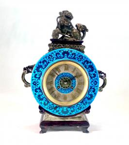 Continental glazed earthenware chinoiserie mantel clock, 15 ¾ inches tall by 11 ¾ inches wide (est. $600-$800).