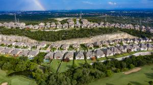 Aerial view of a residential neighborhood in San Antonio with a rainbow.