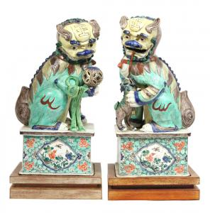 Pair of porcelain Buddhist temple lions, Chinese.