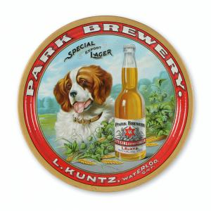 Kuntz tin lithographed beer tray made in Canada and featuring a St. Bernard dog graphic, highly detailed, 13 inches in diameter, with exceptional color and gloss (CA$).