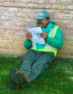 Ruppert employee with 18 years of service reads a thank you note that accompanied his bonus