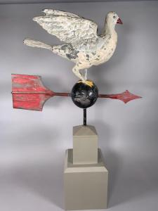 This full-figured white painted standing painted dove weathervane with wings uplifted, on a custom fitted base, is expected to command $400-$700.