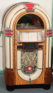 Antique Apparatus reproduction jukebox of a Wurlitzer Model 1015 from the 1940s, geared to play 45rpm records (the original played 78s) and including some 45s ($2,875).