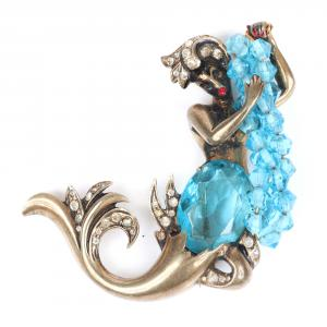 Iconic sterling vermeil mermaid brooch holding strands of aquamarine crystals, with aquamarine crystal torso and red enamel lips (est. $1,200-$1,800).