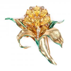 Designer Ruth Kamke's sterling vermeil orchid flower with bright citrine stones bezel and pave clear accents and green enamel, a personal favorite of Kamke's (est. $800-$1,000).