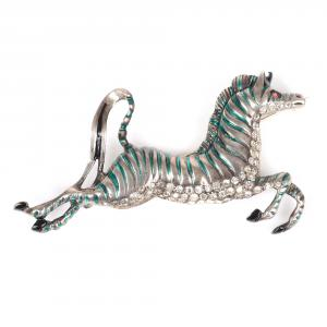 Figural prancing zebra brooch with carved body, green enamel stripes, black enamel accents and clear rhinestones along the belly (est. $600-$800).