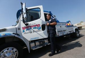 Pepes Towing truck and owner Manny Acosta