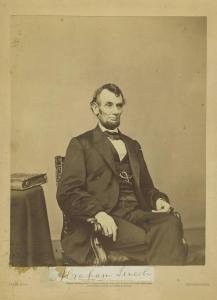 """Brady Studio albumen photo of Abraham Lincoln, of unusual imperial size (8 ¼ inches by 6 ½ inches), with Lincoln's bold presidential signature (as """"Abraham Lincoln"""") (est. 8,000-$9,000)."""