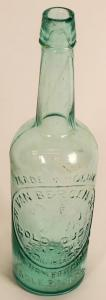Van Bergen Gold Dust whiskey bottle from 1880 in an ultra-rare aqua color in very near perfect condition, with applied top and light whittle (est. $5,000-$7,500).