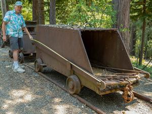 Very large incline ore car used at a major California gold mine (possibly the Miners Foundry in Nevada City), around nine feet long and four feet tall, with ten feet of rail (est. $5,000-$7,000).