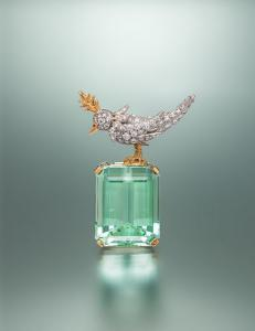 TIFFANY & CO., SCHLUMBERGER, GREEN BERYL AND DIAMOND 'BIRD ON A ROCK' BROOCH Lot 59