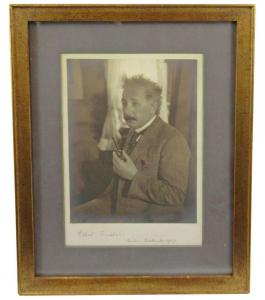 Nicely framed silver gelatin photo of Albert Einstein, a candid bust of him dressed in a dapper suit, signed and dated ('Albert Einstein, Berlin. September 1927') (est. $20,000-$30,000).