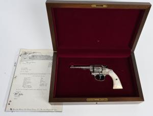 Antique 1897 Colt .32-caliber 'New Police' revolver with American-scroll engraving by Cuno Helfricht. Solid 99% gun with near-mint bore and action. Comes in modern Colt walnut fitted case. Estimate $7,000-$10,000