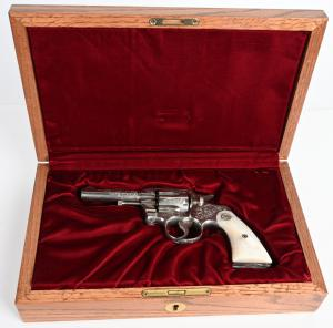Colt .38-caliber Army Special revolver factory-engraved by William Gough (or his shop). Manufactured in 1924 and shipped to Walter G. Clarke Co., Omaha, Nebraska. Like-new bore and action. Modern Colt walnut display case. Estimate $8,000-$12,000