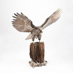 Exquisite 28-inch-tall 20th century Buccellati sterling figure of a bird of prey perched on a naturalistic stump, marked to the back of the tailfeather with the maker's mark ($27,225).