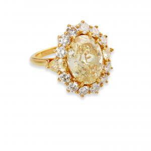 Tiffany & Co. 5.41-carat oval brilliant cut natural fancy yellow diamond ring, from the collection of Mary and Lou Silver of Indian Wells, California ($50,000).