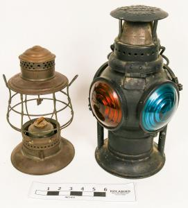 "Pair of circa 1910-1920 railroad signal lamps, one the four-color Adlake lamp, a prize for any collector, the other marked ""SP & Co."", for Southern Pacific Railway ($5,375)."
