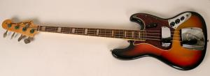 Beautiful, American-made 1970s Fender jazz bass guitar, the Cadillac of Fender bass guitars, serial #282180, with a sunburst finish and a rosewood fret board ($3,375).