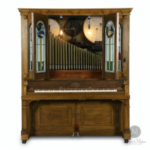 """Early 1900s Seeburg Style """"G"""" orchestrion, a coin-op mechanical masterpiece, 66 inches tall by 79 inches wide, with mosaic leaded art glass doors, comes with13 """"G"""" rolls (CA$24,780)."""
