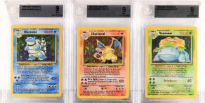 Group of three1999 Pokémon Base Unlimited holographic trading cards – Blastoise, Charizard and Venusaur – all graded well at BGS 9 Mint.