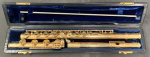 "14kt gold handmade custom flute, engraved by the maker, ""Verne Q. Powell, Boston"", dated to 1951 or 1952, serial #1299, with non-gold valves and original fitted leather case ($17,825)."