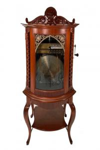 Circa 1880 Regina upright automatic disc box, 5 feet 7 inches tall, with 20 15 ½ inch discs, in fine playing condition, in a cabinet that had been restored and refinished ($9,225).