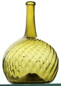 Pattern globular bottle made by Zanesville Glass Works in Ohio circa 1815-1835, medium yellow olive in color, with a 24-rib pattern swirled to the right, 8 inches tall ($7,500).