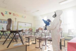 A Volunteer Minister fogs a school in Aruba with Decon7, a powerful hydrogen-peroxide decontamination substance that has a proven record of neutralizing bacteria and viruses.