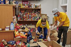 Scientologists sort donations for distribution to underserved residents.