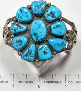 Turquoise cluster bracelet by the well-known Navajo silversmith Ella Peter, boasting beautiful dark blue turquoise stones, flanked on both sides by nice silver work, signed (est. $550-$650).