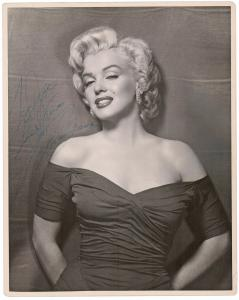 """Black and white photograph of Marilyn Monroe signed and inscribed """"to Joe"""" (possibly Joe DiMaggio), unusually large at 11 inches by 14 inches (est. $20,000-$25,000)."""