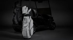 New VESSEL Lux XV Golf Cart Bags shown in all-black and all-white. Each bag is fitted with matching golf head covers.