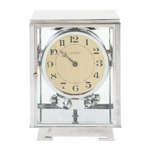 French Atmos perpetual time clock from the 1940s, 9 ½ inches tall, with metal chrome plated and glass case and painted metal dial with Arabic numerals (CA$6,490).