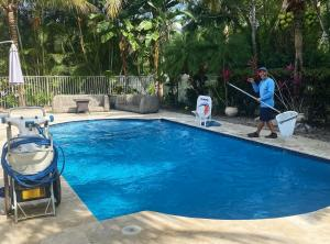 Photo Of Elements Pools Service Technician Performing Weekly Pool Maintenance Palm Beach, Florida
