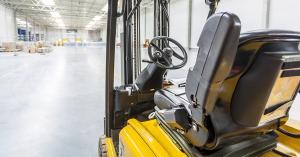 forklift charging in warehouse
