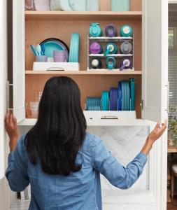 YouCopia's flexible products help organize everything from food container lids and water bottles to dishes and glasses in the upper cabinet.