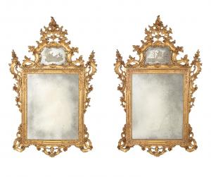Impressive pair of late 19th century Italian Rococo style giltwood mirrors (est. $10,000-$15,000).
