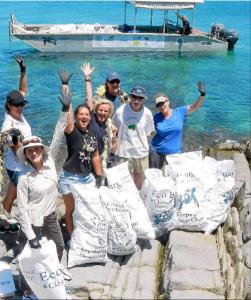 Beach Clean Up in the Whitsundays with eco Barge Clean Seas