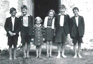 A group of 5 barefoot children, Krunchie at the very right