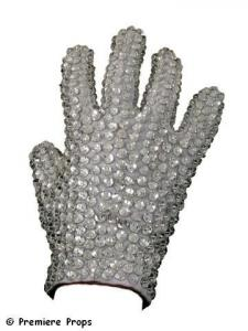 """Actual glove worn on-stage by Michael Jackson during his """"Victory"""" tour, a large white """"tux-style"""" glove covered in crystals – palm front and back and all the fingers. (est. $50,000-$60,000)."""