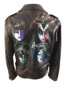 Leather jacket of the four original band members of KISS, featuring hand-painted pictures of each on the back and signed by all four (est. $3,000-$4,000).