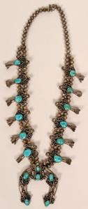Navajo turquoise squash blossom necklace from around the 1950s or '60s, an unmarked naja piece 15 ½ inches long and boasting a nice patina built up on all the silver (est. $1,900-$2,400).