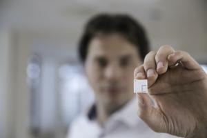 Our founder holding the worlds smallest wireless sensor