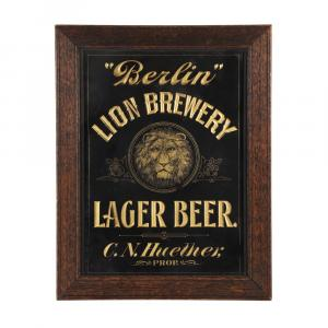 Rare 'Berlin' Lion Brewery tin litho sign, Canadian, 1901, the only example known to exist, 14 inches by 19 inches (sight, less oak frame), the center depicting a lion's head (CA$8,179).