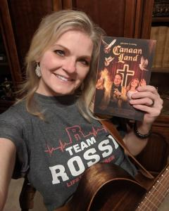 Kelly, president of Richard Rossi Fan Club, with the Canaan Land novel