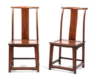 Pair of Chinese hardwood side chairs, height 41in (104cm); width 19in (48cm); depth of seat 16in (40.5cm), estimate $10,000-$15,000.